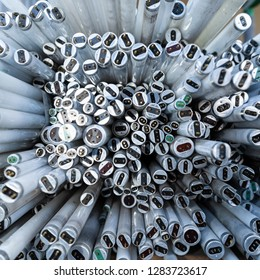 Close-up of a stack of disused and discarded neon lamp tubes waiting for recycling