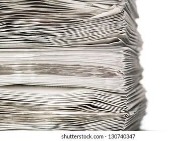 A closeup of a stack of newspapers