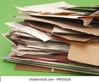 Close-up of stack of paper and cardboard for recycling. Selective focus