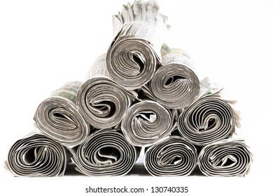 A closeup of a stack of  rolled up newspapers ready to be delivered