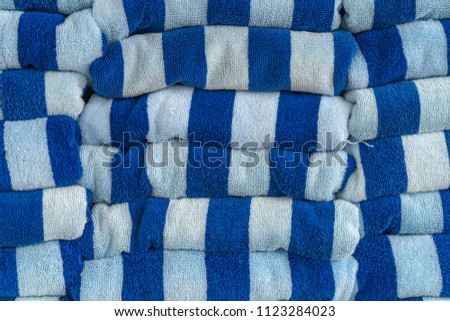 87897c87ea Closeup stack or row of white and blue striped cotton bath towels