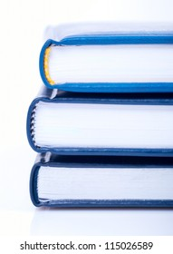 Close-up stack of three blue books or diary on white background