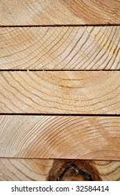 Closeup of Stacked Lumber for construction, background,vertical