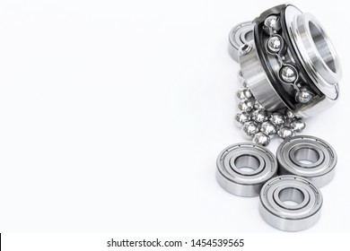 Close-up stainless steel bearings on white background.