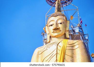 Close-Up of Standing Buddha Statue at Wat Intharawihan in Bangkok, Thailand