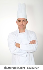 Closeup of standing chef on white background
