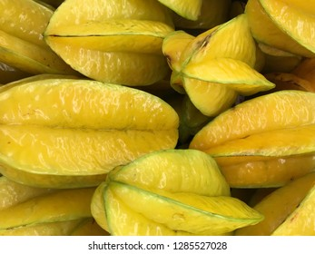Close-up star fruit carambola or star apple ( starfruit ) Averrhoa carambola, gooseberry, star apple, or Carambola. These are a group of yellow green fruit found in tropical Thailand area.