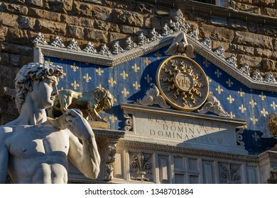 Close-up of Statue of the David of Michelangelo Buonarroti, masterpiece of Renaissance sculpture in Piazza della Signoria and the Palazzo Vecchio in Florence, Italy, Europe