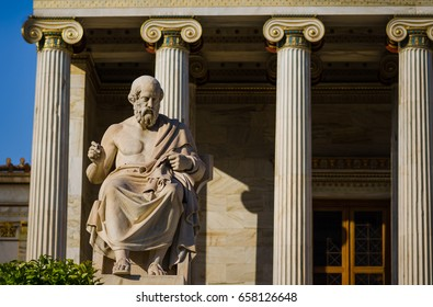 Close-up statue of the Greek philosopher Plato on the background of classical columns