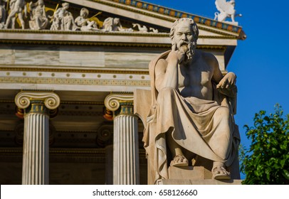 Close-up statue of the Greek philosopher Socrates on the background of classical columns