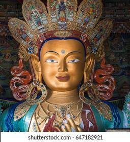 closeup of The statue of Maitreya Buddha at Thikse monastery