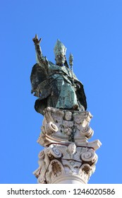 Close-up of the statue of Sant'Oronzo, patron saint of the city of Lecce, in Salento, Puglia, Italy. The statue is positioned above a column in the main square of Lecce.