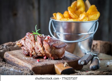 Closeup of steak and chips with rosemary and salt