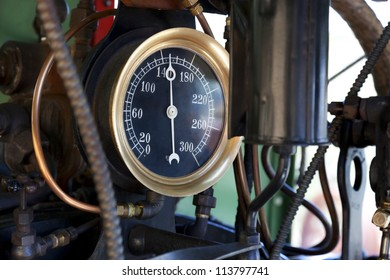 Closeup of steam pressure guage in cab of working vintage steam train locomotive.