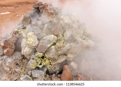 Closeup from steaming sulphur fumaroles at geothermal area Hverir in north Iceland