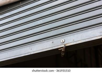 Close-up of steel sliding doors with master key, Metal sheet slide door texture