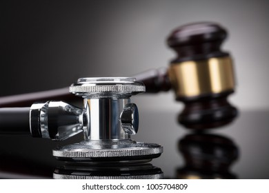Close-up Of A Stethoscope In Front Of Gavel