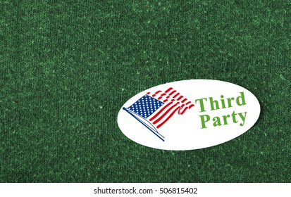 """Closeup of a sticker with an American flag and the words """"Third Party"""" placed on a green shirt."""