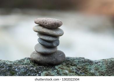 Closeup of stone balance on rock in border river