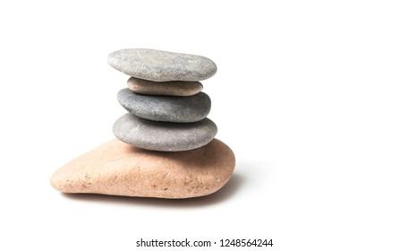 closeup of stone balance on white background