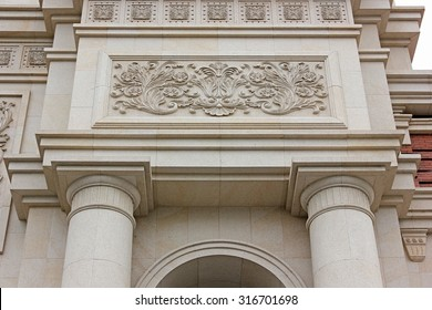 Close-up of stone building decoration.