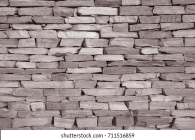 Closeup of Stone Wall Background in Black and White Sepia Tone