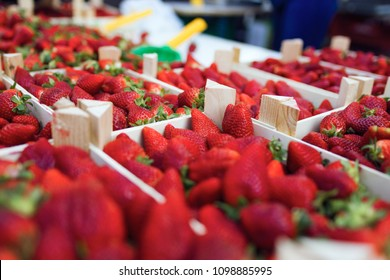 Close-up of strawberries trays in the street market.