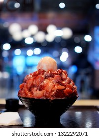Closeup Strawberry Bingsu on tabl, Bingsu or Bingsoo is a Korean is a popular Korean shaved ice dessert with sweet toppings that include strawberry, condensed milk, fruit syrup, and ice-cream.