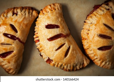 Close-up of Strawberry Hand Pies Fresh Out of the Oven on Parchment Paper