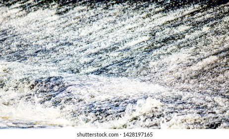 Close-up of the stream of the river Shannon in the town of Athlone in the county of Westmeath Ireland, clean and crystal clear water moving downstream