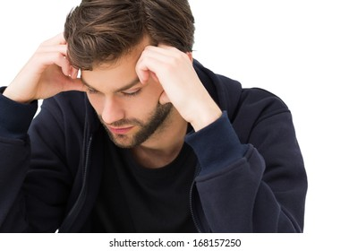Close-up of a stressed handsome young man over white background