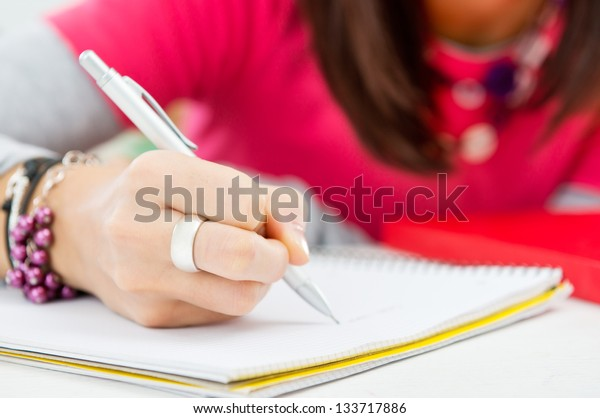 Closeup Of Student Hand Writing On Paper