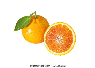 closeup studio photo of one orange with half nice and juicy full of water drops isolated on white background