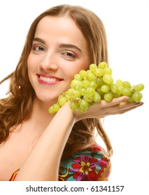 Close-up studio portrait of a girl with a bunch of grapes isolated on white background