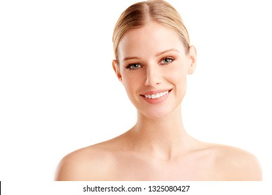 Close-up studio portrait shot of beautiful young woman with flawless skin looking at camera and smiling. Isolated on white. background.
