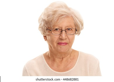 Close-up studio shot of an elderly lady with glasses isolated on white background