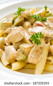 Close-up studio shot of Penne Chicken Alfredo in rich creamy sauce. Ideal for blog and recipe books