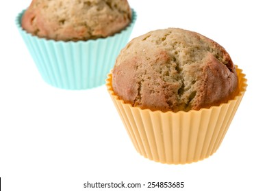 Close-up studio shots of cupcakes on a white background