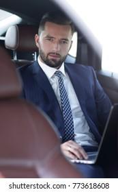Close-up of a successful businessman sitting in a car