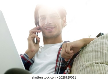close-up of a successful guy talking to a smartphone