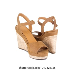 Closeup of suede espadrille wedges isolated on white. Classy tan sandals.
