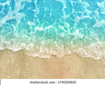 Close-Up of Summer Blue Water Wave Tide and Sea Foam Washing Up on Ocean Beach Sand Texture, Directly Above
