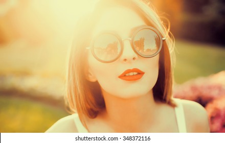 Close-up sunglasses on sunset,glowing skin,amazing hairstyle,red lips, long healthy blowing hair running on the Spring Field, Sun Light. Glow Sun. Free Happy Woman. Toned in warm colors,amazing style