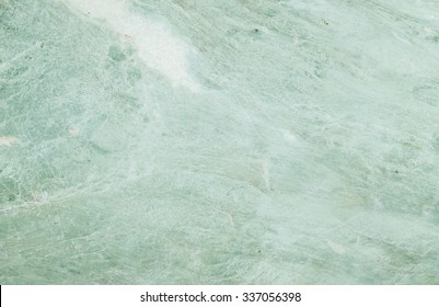 Closeup surface marble stone pattern at the color marble stone wall texture background , abstract green marble stone wall , green jade pattern