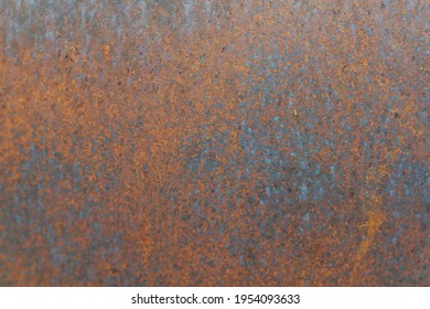 Closeup of Surface peeling old car paint cracked with rusty background
