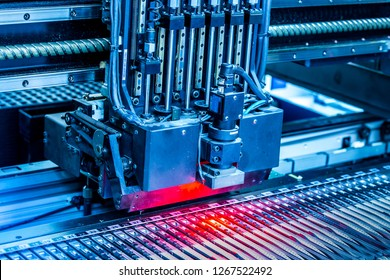 Close-up surface-mounting machine in progress. SMT (surface-mount technology) is a method for producing electronic circuits. Components are placed directly onto the surface of printed circuit boards.