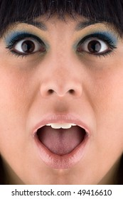 A closeup of a surprised or startled young woman's face.