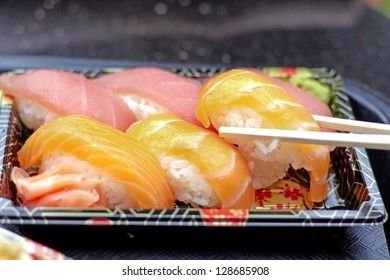Close-up of sushi with different kinds of fresh fish. Horizontal Shot.