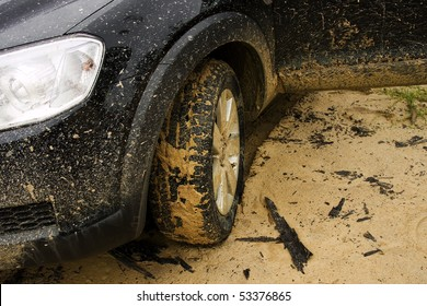 Closeup of SUV on a dirt and muddy road in Mozambique