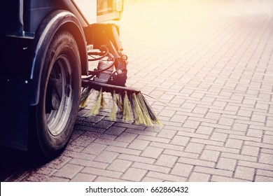Close-up sweeper machine cleaning. Concept clean streets from debris.